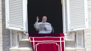 Pope Francis delivers his blessing to faithful during the Angelus prayer from the window of his studio overlooking St Peter's Square at the Vatican (Alessandra Tarantino/AP)