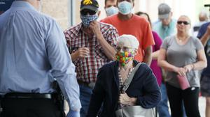 People wearing face masks wait to enter a casino in Altoona, Iowa (AP/Charlie Neibergall)