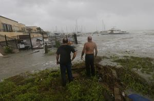 Boat owners examine the damage after the docks at the marina where their boats had been secured were destroyed as Hurricane Hanna made landfall in Corpus Christi, Texas (Eric Gay/AP)