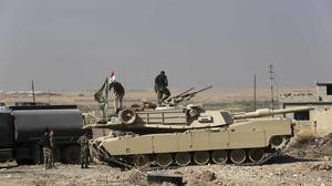 Iraqi forces are deployed during an offensive to retake Mosul from Islamic State militants (AP)