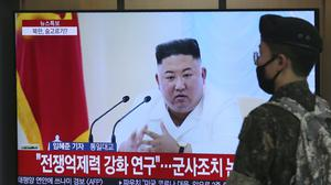 A South Korean army soldier passes by a TV showing a file image of North Korean leader Kim Jong Un (Ahn Young-joon/AP)