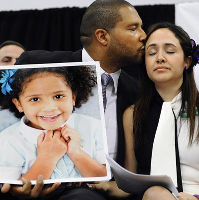 Jimmy Greene and his wife Nelba hold a portrait of their daughter, Sandy Hook shooting victim Ana Marquez-Greene. (AP/Jessica Hill)