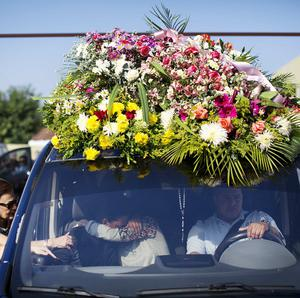 Relatives of Genesis Carmona, embrace inside the hearse carrying her body during her funeral (AP)