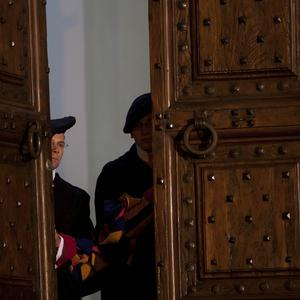 Vatican Swiss guards close the main door of the papal residence in Castel Gandolfo, south of Rome (AP)