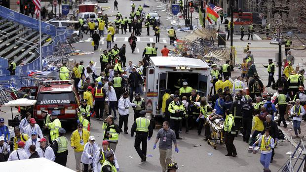 Medical workers aid injured people following the bombing at the finish line of the 2013 Boston Marathon (AP/file)