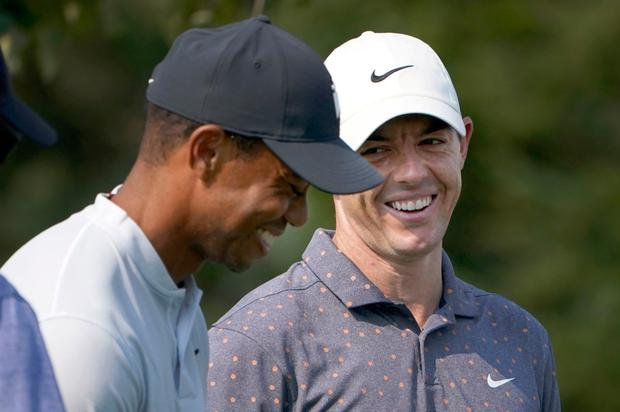 Friendly rivalry: Tiger Woods shares a lighter moment with Rory McIlroy