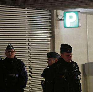 Police guard the entrance of a underground car park near Paris where the suspected gunman was arrested.