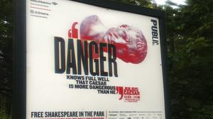 A sign promoting The Public Theatre's production of Julius Caesar in New York's Central Park (AP)