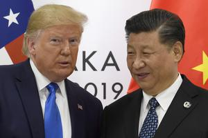 President Donald Trump poses for a photo with Chinese President Xi Jinping at last year's G-20 summit in Osaka. Relations between the two countries have nosedived this year (Susan Walsh/AP)