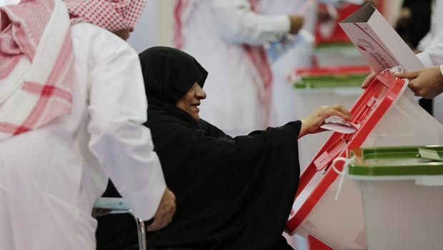 A woman casting her ballot in the first round of voting in Bahrain last Saturday (AP)