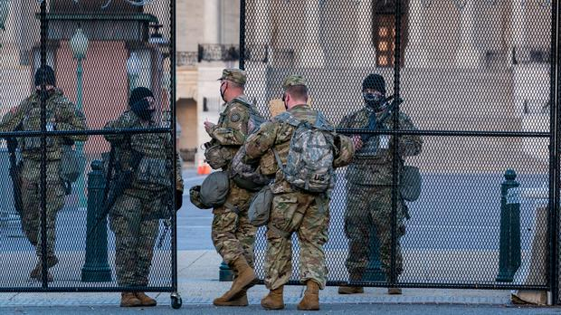 National Guard troops keep watch at the Capitol in Washington (J Scott Applewhite/AP)
