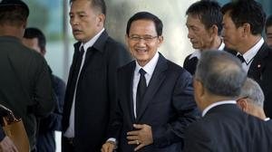 Thailand's former prime minister Somchai Wongsawat arrives at court in Bangkok (AP Photo/Gemunu Amarasinghe)