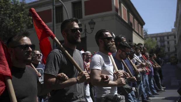 Members of the Communist-affiliated PAME labor union gather during a rally in Athens (AP)