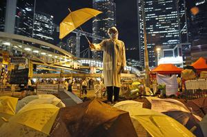 A protester holds an umbrella during the demonstrations in 2014 (Kin Cheung/AP/file)