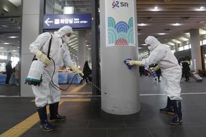 Employees work to prevent a new coronavirus at Suseo Station in Seoul, South Korea (Ahn Young-joon/AP)