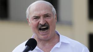 Belarus President Alexander Lukashenko addresses his supporters gathered at Independent Square in Minsk (Dmitri Lovetsky/AP)