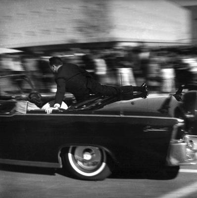 The limousine carrying the mortally wounded Kennedy races toward the hospital seconds after he was shot in Dallas (AP).