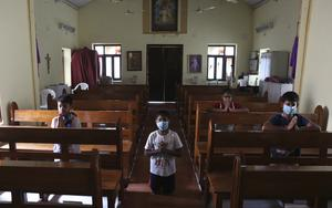 Catholic devotees offer prayers at Our Lady of Lourdes Church on Good Friday, during a lockdown to control the spread of the new coronavirus in Hyderabad, India, Friday, April 10, 2020. (AP Photo/Mahesh Kumar A.)