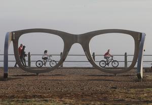 People exercise on the promenade in Cape Town (NArdus Englebrecht/AP)