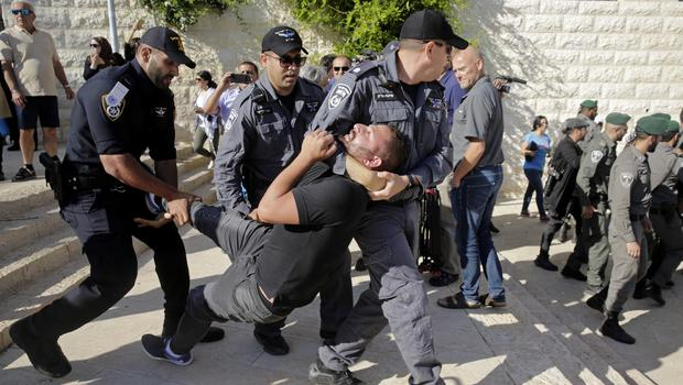 Israeli police officers detain a demonstrator during a protest outside the US embassy in Jerusalem (Mahmoud Illean/AP)