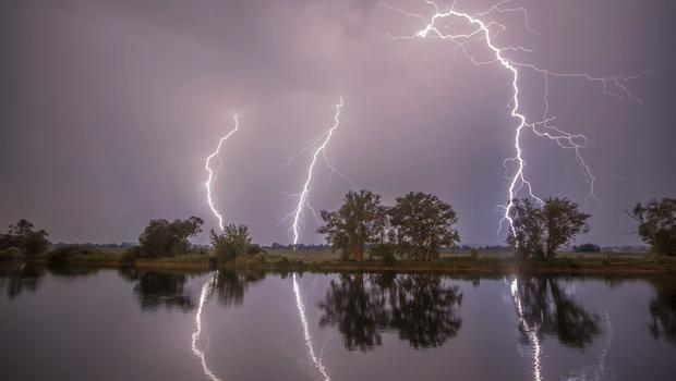Thunderbolts are reflected near Premnitz, eastern Germany (Julian Staehle/dpa via AP)