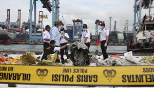 Indonesian National Transportation Safety Committee (KNKT) investigators have inspected debris (Achmad Ibrahim/AP)