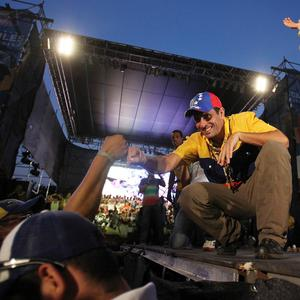Opposition presidential candidate Henrique Capriles greets supporters at his closing campaign rally in Barquisimeto, Venezuela (AP)
