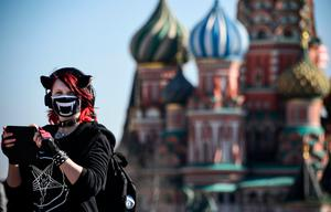 A woman wears a mask in Moscow
