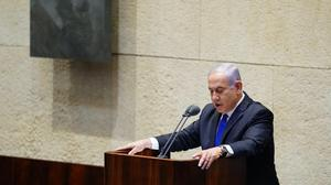 Israeli Prime Minister Benjamin Netanyahu speaks during a swearing in ceremony of his new unity government (Adina Valman/Knesset Spokespersons' Office via AP)