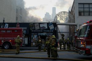About 200 firefighters attended the scene on Saturday evening (Ringo HW Chiu/AP)