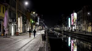 The Navigli district of Milan, one of the area of night life in Milan, is almost deserted after most bars were closed (AP)