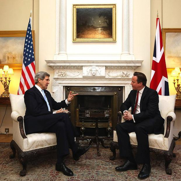 Prime David Cameron welcomes US Secretary of State John Kerry to 10 Downing Street