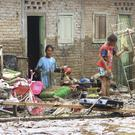 Residents clean up their flood-damaged house in Central Tapanuli (Damai Mendrofa?AP)