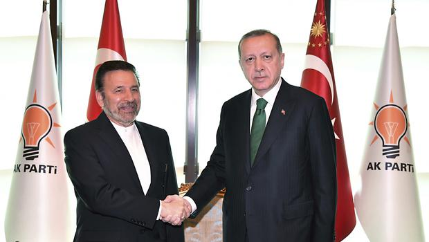 President of Turkey Recep Tayyip Erdogan, right, shakes hands with Mahmoud Vaezi, special envoy of Iranian President Hassan Rouhani, at his ruling party headquarters in Ankara (AP)