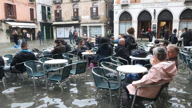 Tourists and residents resume their normal routine at a bar in Venice (Emiliano Creeps/ANSA/AP)