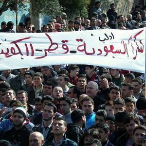 Anti-Syrian regime protesters during a demonstration, in Idlib province, northern Syria (AP)
