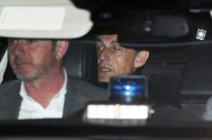 Nicolas Sarkozy is driven away from the police station in Nanterre (Francois Mori/AP)