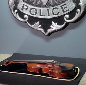 The stolen £3 million Stradivarius violin is displayed at the Milwaukee Police Department (AP)