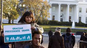 Israel Montalvo and his daughter Brianna show their support for Barack Obama's immigration reform at a rally in front of the White House (AP)