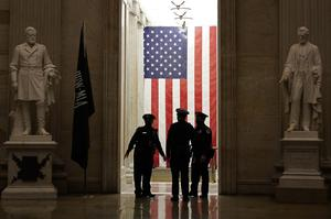 Capitol Police officers talk in the Capitol Rotunda on Capitol Hill in Washington (Susan Walsh/AP)
