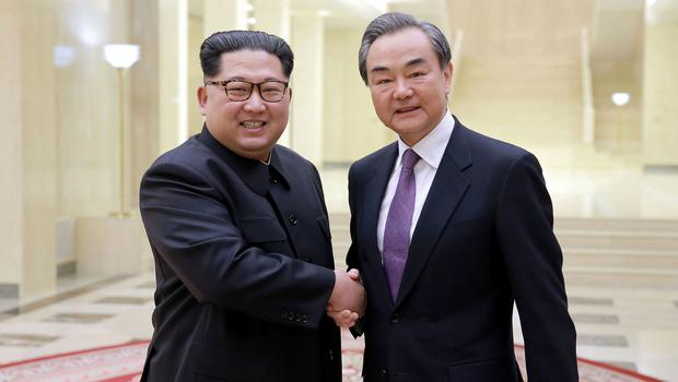 Chinese foreign minister Wang Yi poses with North Korean leader Kim Jong Un for a photo in Pyongyang last week (Korean Central News Agency/Korea News Service via AP)