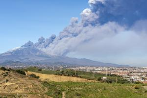 A smoke column rises from Mount Etna (Salvatore Allegra/AP)