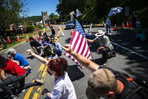 Demonstrators outside West Point kneel during a solidarity protest for George Floyd (AP)