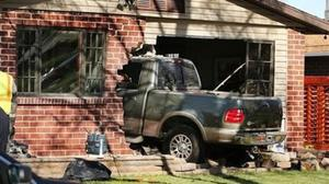 The truck smashed into a house in Rose Park Utah (AP/The Deseret News)