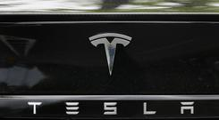 A US government agency is looking into allegations that all three of Tesla's electric vehicles can suddenly accelerate on their own (PA)