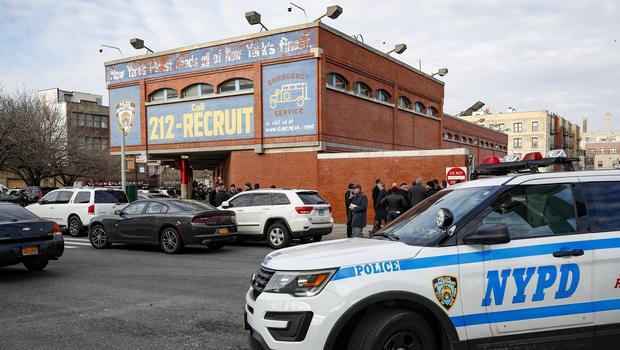 Officers work the scene of a police shooting outside the 41st precinct in New York (John Minchillo/AP)