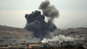 Thick smoke rises following an airstrike by the US-led coalition in Kobani (AP)