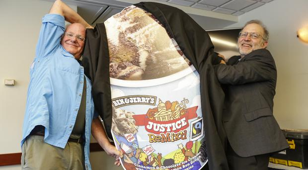 Ben Cohen and Jerry Greenfield unveil their newest flavor, Justice ReMix'd on Tuesday (Eric Kayne/AP)
