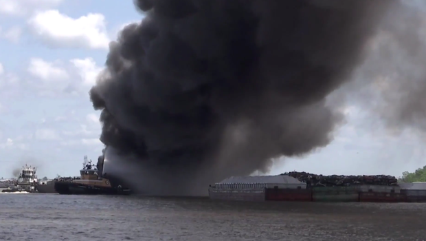 The barge caught fire on the Mobile River in Alabama (Screengrab/AP)