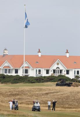 US President Donald Trump plays a round of golf on the Turnberry resort in Scotland (Andrew Milligan/PA)